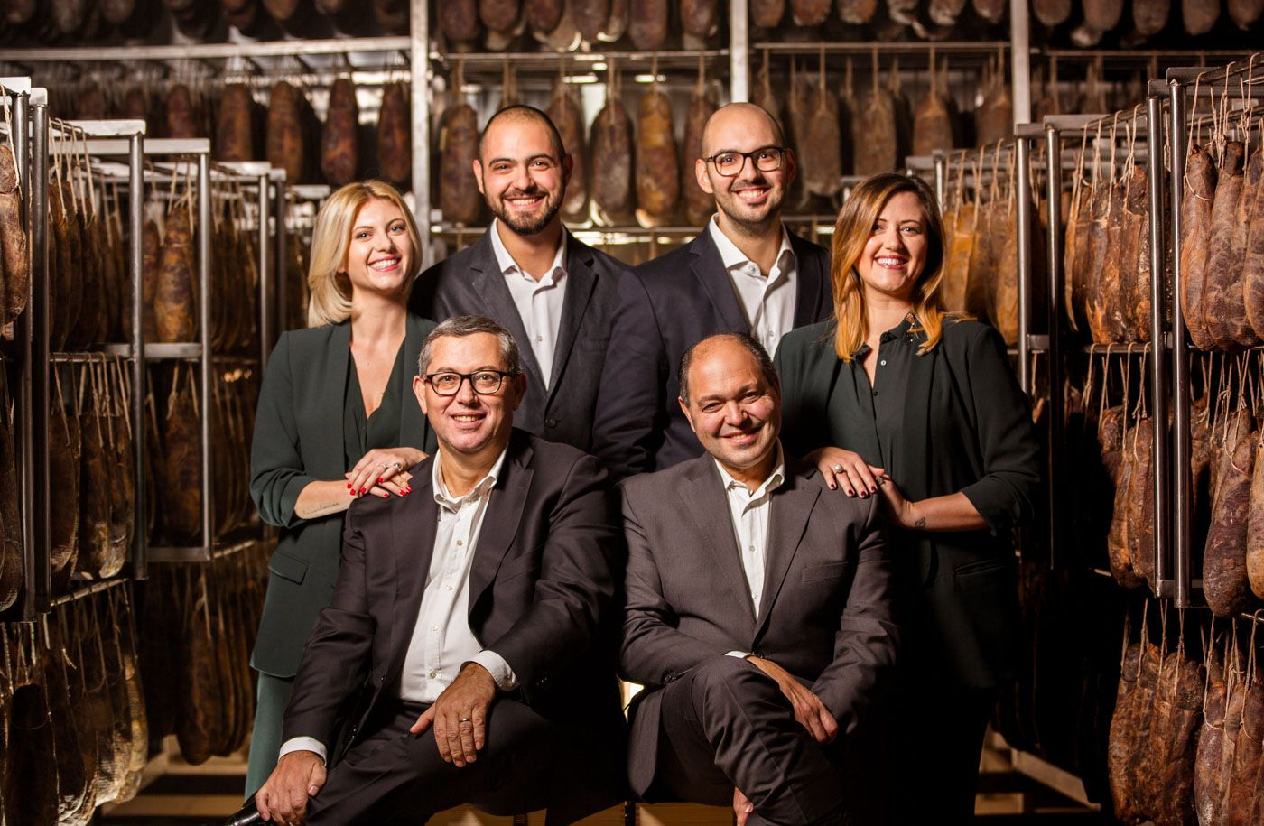 Photo portrait of the owners and founders of Salumificio Santoro
