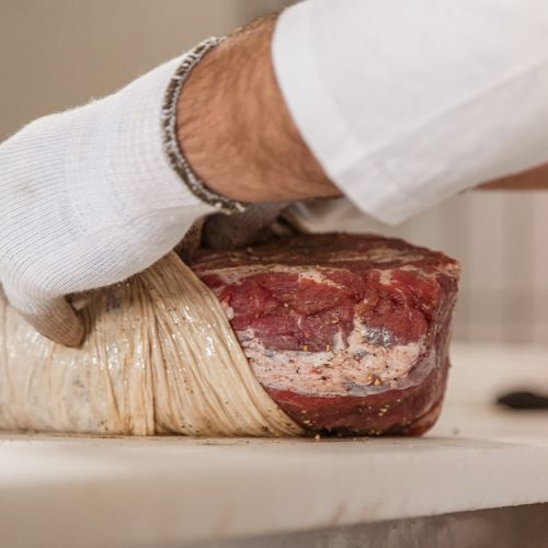 Bagging of the meat during the making of the Apulian Capocollo