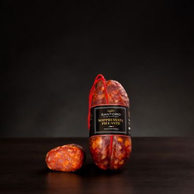 Whole and sliced piece of Santoro spicy Soprressata