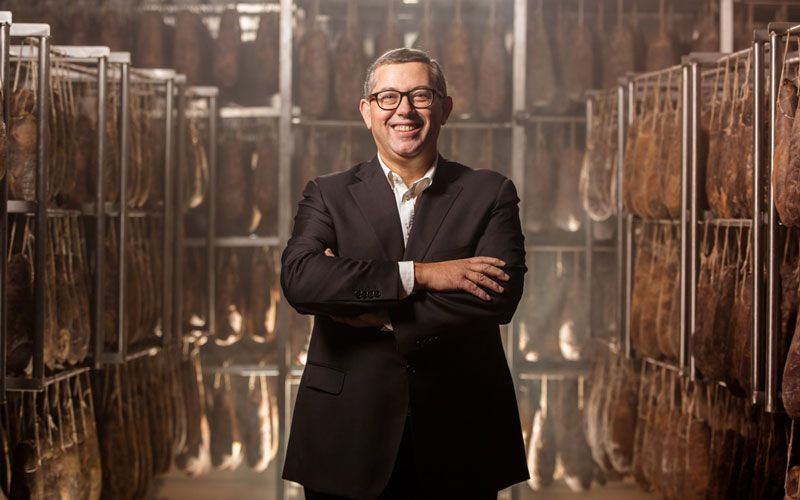 Photo portrait of Giuseppe Santoro in the production center of the salumificio