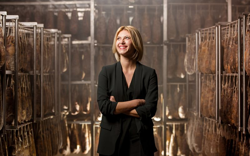 Photo portrait of Micaela Santoro in the production center of the salumificio